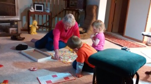 Marna teaching the kids Chutes and Ladders